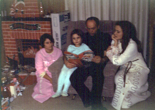 "Christmas Eve 1970 reading ""A Visit from St. Nicholas"" in front of the magical cardboard fireplace."