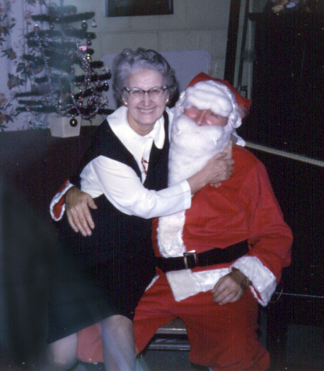 "Grandma with ""Santa,"" 1964. My sister didn't know until years later than Grandpa was the one playing Santa. (We assume that Grandma knew.)"