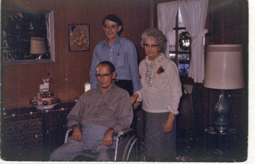 Harold Young (seated) with his sister Adah (Young) Johnson and his son David. 1972.